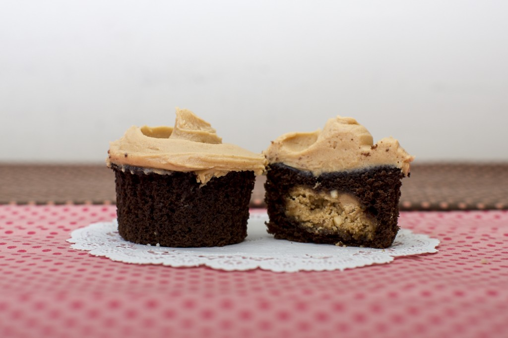 Devil's Food cupcake with peanut butter cookie inside topped with peanut butter frosting