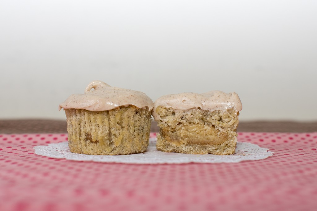 Apple cupcake with honey cookie inside topped with honey cinnamon frosting